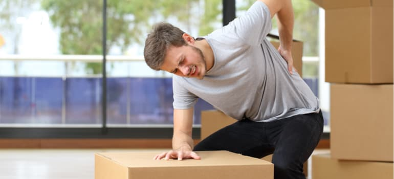Lifting Heavy Loads! - Back Pain - Caterham Chiropractic Clinic